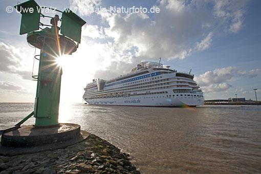 Ship passage Holiday ship AIDAsol on the Quay near Emden
